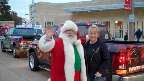 Santa with truck delivering toy drive.