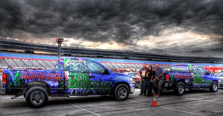 Dark overcast skies make the perfect backdrop for Boneyard Trucks at TMS